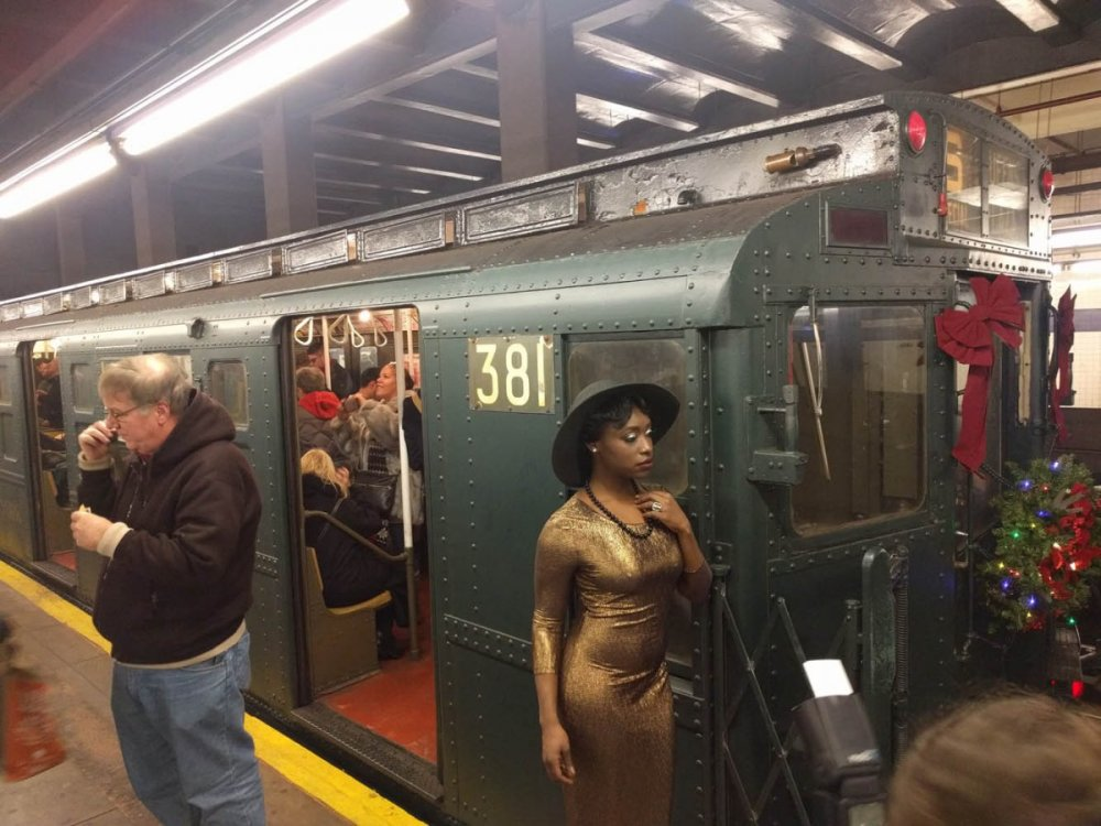 while-the-train-was-stopped-people-dressed-in-anachronistic-clothing-posed-for-photos-next-to-the-antique-train-cars.jpg